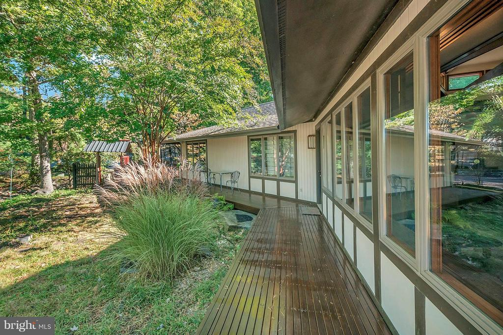 Extensive decking surrounds this property. - 111 BOXWOOD TRL, LOCUST GROVE