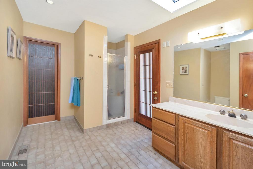 Second master bath with outside deck access. - 111 BOXWOOD TRL, LOCUST GROVE