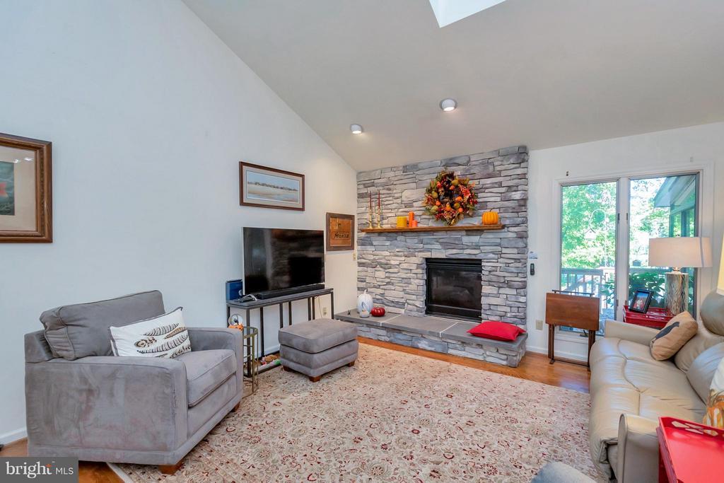 Family room boasts a gorgeous stone fireplace - 542 HARRISON CIR, LOCUST GROVE
