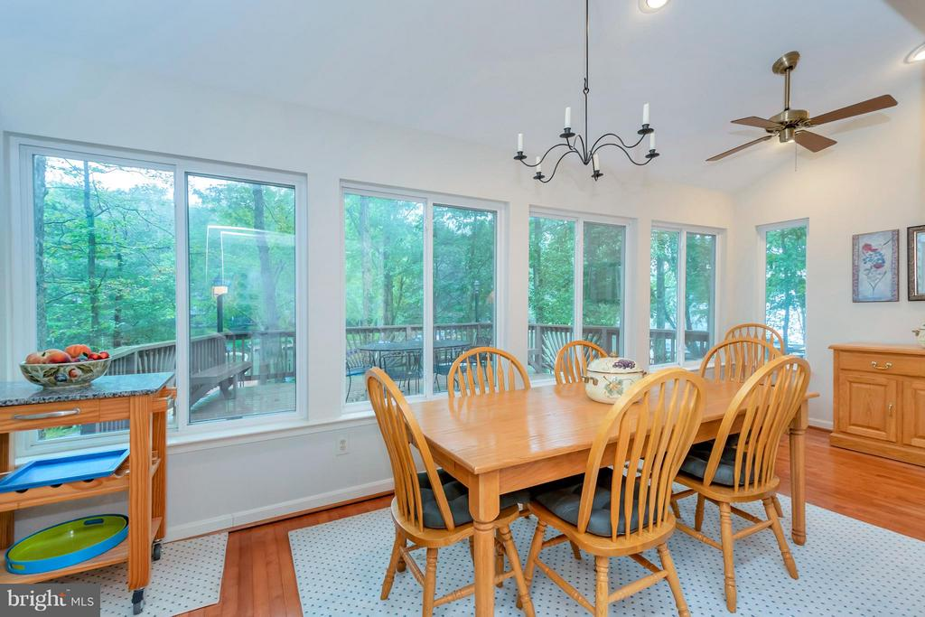 Wall of windows with water views and deck access - 215 SKYLINE RD, LOCUST GROVE