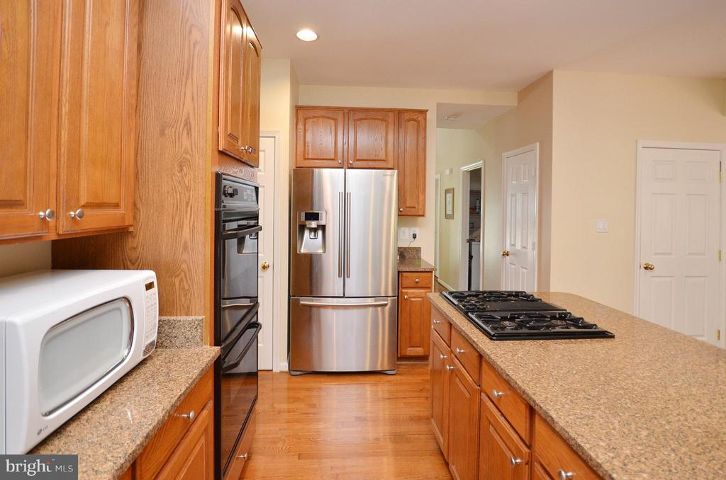 Kitchen with New Refrigerator and Dishwasher - 20532 DEERWATCH PL, ASHBURN