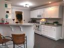 Cheery kitchen boasts Corian countertops - 70 OWL AVE, MARTINSBURG