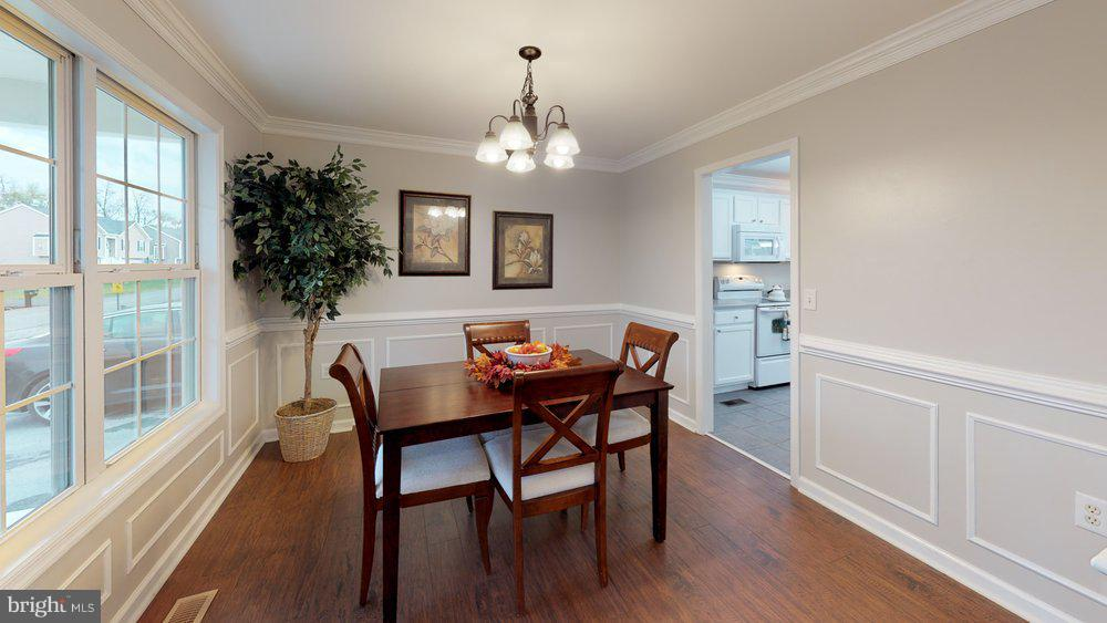 Formal dining area with eye catching details - 70 OWL AVE, MARTINSBURG