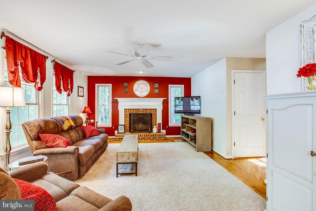 Family Room with Wood Fireplace - 12647 BELLEFLOWER LN, FREDERICKSBURG