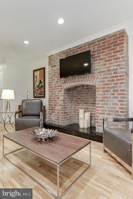Close up of exposed brick feature in living room. - 1830 JEFFERSON PL NW #1, WASHINGTON
