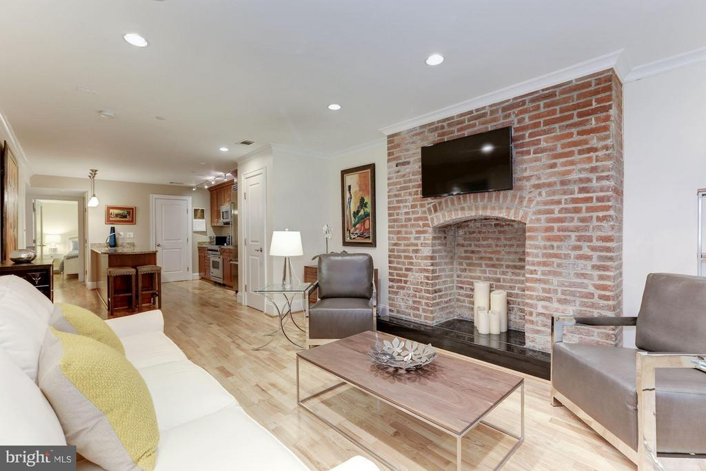 Living Room with exposed brick feature - 1830 JEFFERSON PL NW #1, WASHINGTON