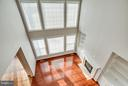 View from upstairs hallway to family room below - 16585 SPACE MORE CIR, WOODBRIDGE