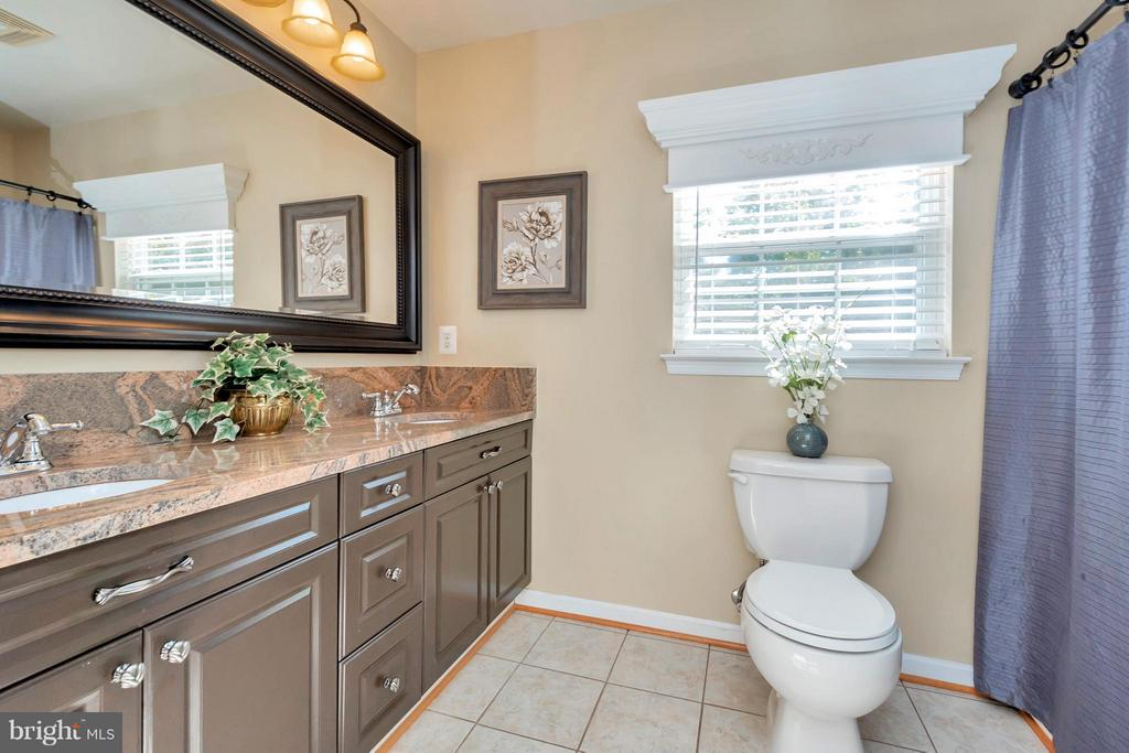 Master bath with tile floors and granite counters - 316 LIBERTY BLVD, LOCUST GROVE