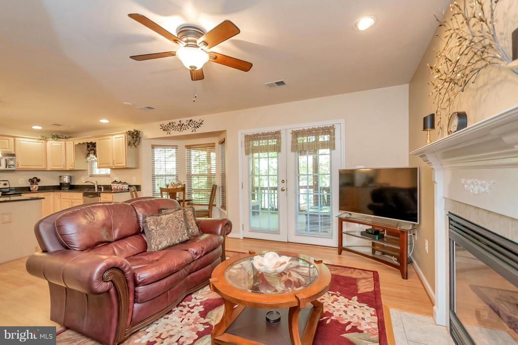 Family Room open to kitchen and screened porch - 316 LIBERTY BLVD, LOCUST GROVE