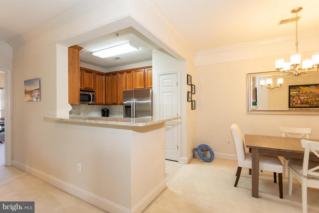 Renovated kitchen overlooking dining and living - 11314 WESTBROOK MILL LN #303, FAIRFAX