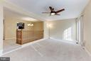 Family room with new contemporary ceiling fan. - 43979 CHOPTANK TER, ASHBURN