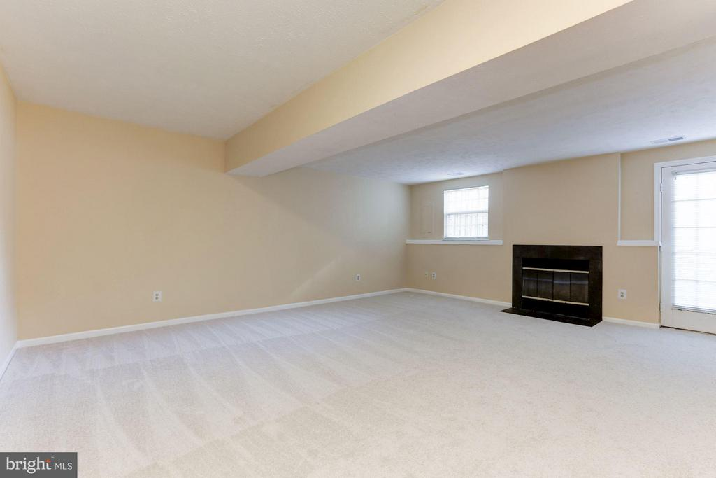 Lower lvl rec room with fireplace. - 43979 CHOPTANK TER, ASHBURN