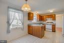 Kitchen open to Breakfast Nook/Family Room - 9811 FAIRMONT AVE, MANASSAS