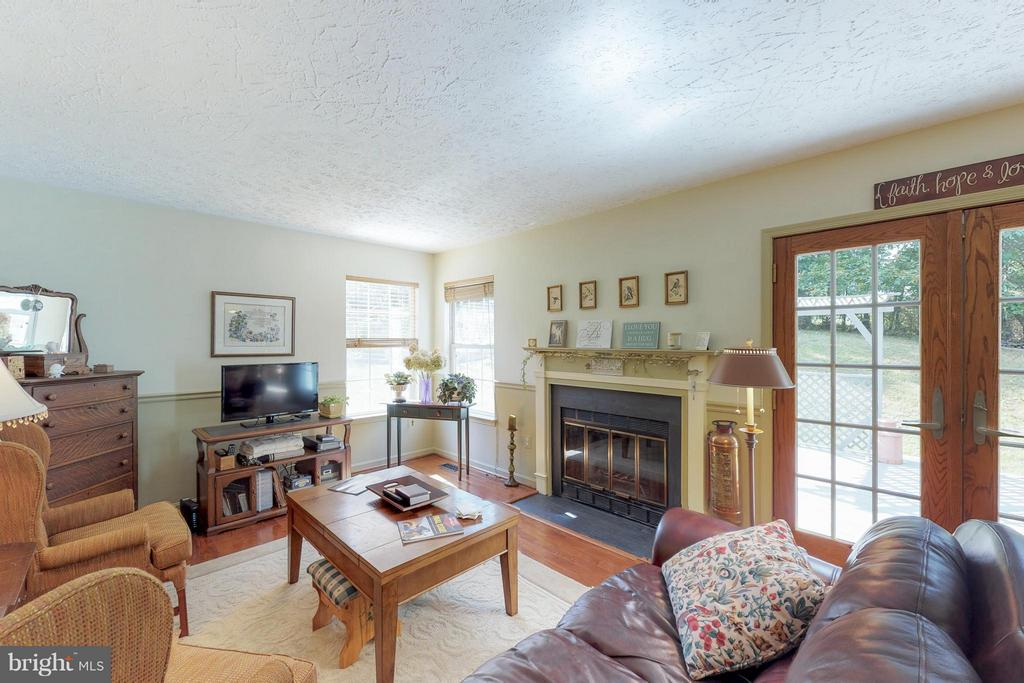 Family Room with Wood Burning Fireplace - 151 MORNING GLORY DR, WINCHESTER