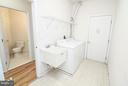 Main level laundry and powder room - 25917 QUINLAN ST, CHANTILLY