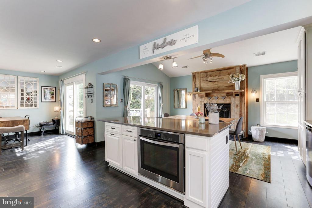 KITCHEN - OPENS BEAUTIFULLY TO COZY WOOD FIREPLACE - 415 CLAGETT ST SW, LEESBURG