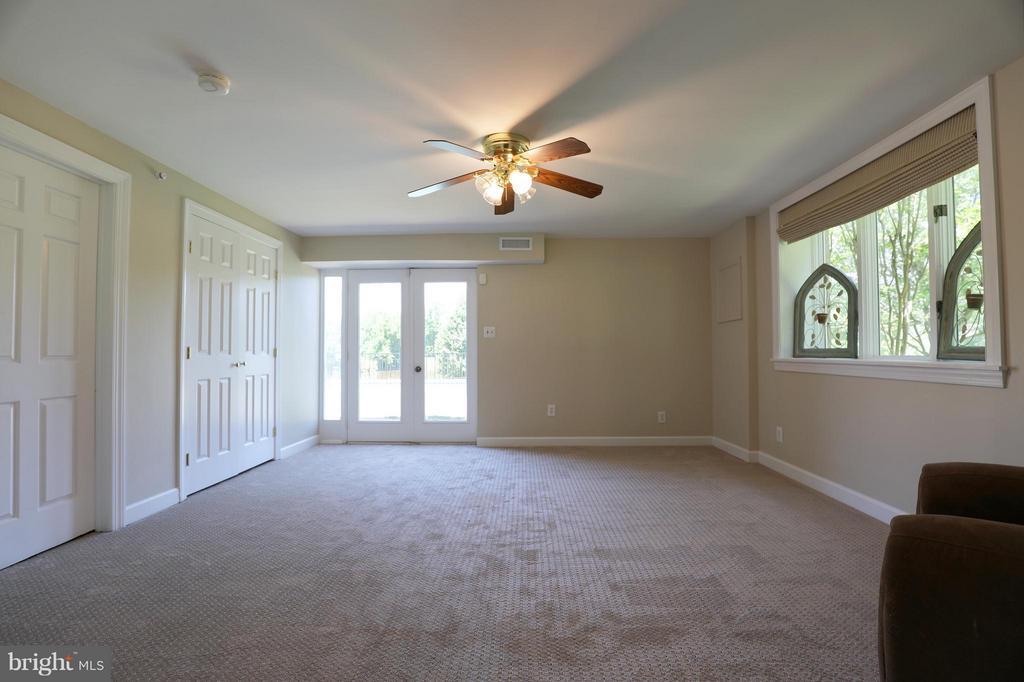 Basement Living room. Private entrance. - 13108 LAUREL GLEN RD, CLIFTON
