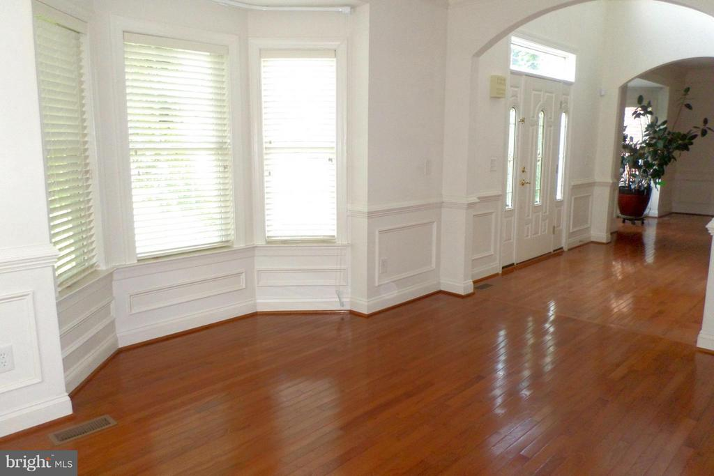 Natural Light pours into the formal Living -Dining - 13504 CLASSIC OAKS CT, MANASSAS