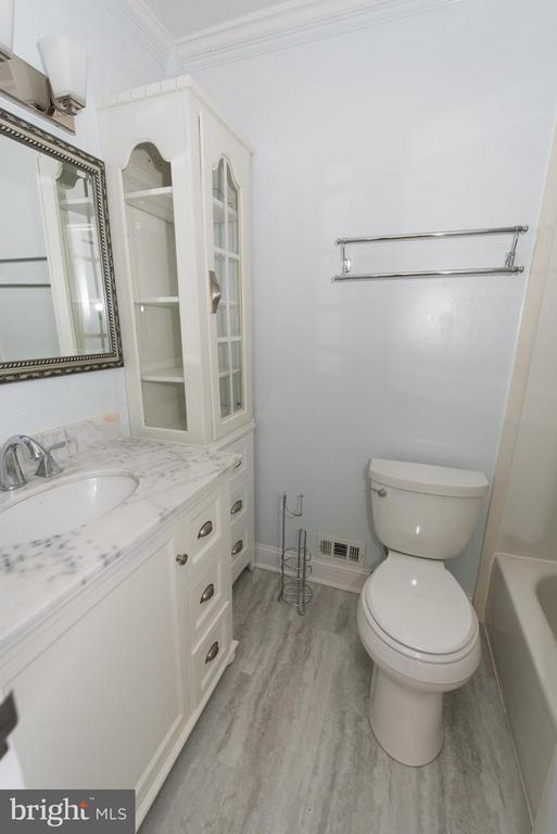 Beautiful master bath with  new vanity & flooring - 2358 SOFT WIND CT, RESTON