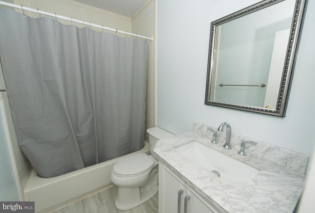 Updated hall bath - 2358 SOFT WIND CT, RESTON