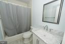 Updated hall bath - 2358 SOFT WIND CT, RESTON
