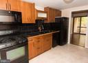 Beautifully updated kitchen with Gas Range - 2358 SOFT WIND CT, RESTON