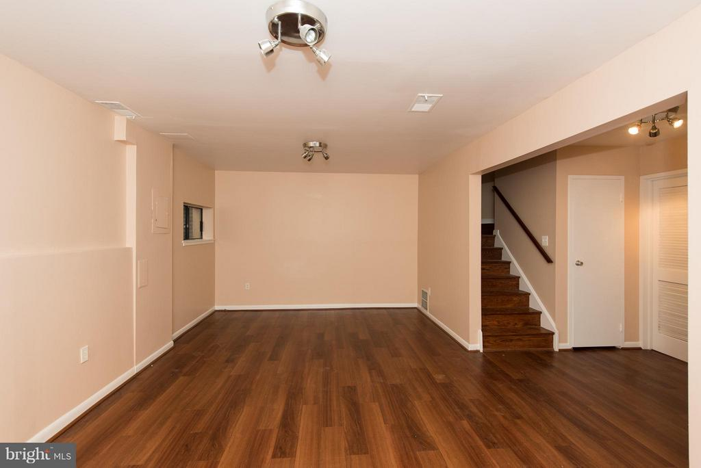 Lower level family room with new flooring - 2358 SOFT WIND CT, RESTON
