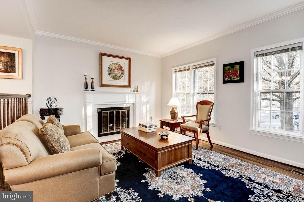 woodburning fireplace and tall windows add  appeal - 2 S MONTANA ST, ARLINGTON
