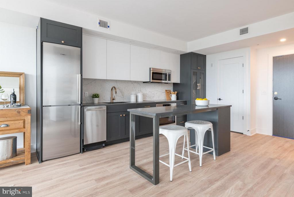 Kitchen - fixed island, quartz countertops - 801 VIRGINIA AVE SE #406, WASHINGTON