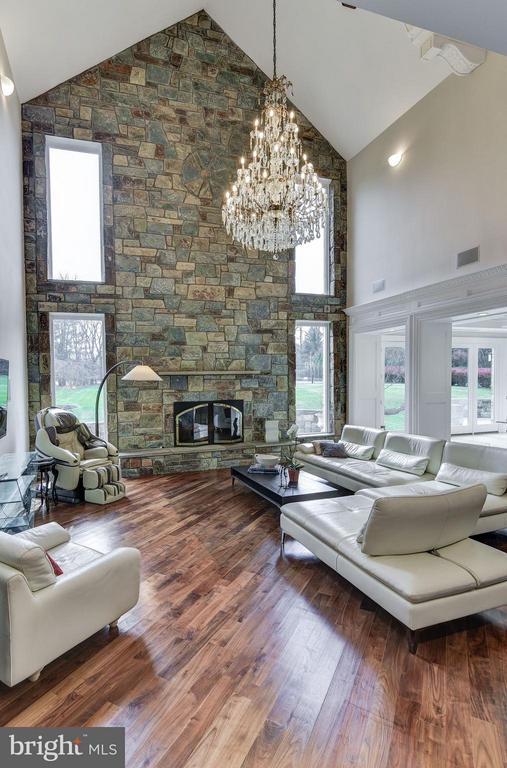 Family Room with Vaulted Ceiling and Chandelier - 10408 BIT AND SPUR LN, POTOMAC