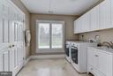 Laundry Room with Linen Closets - 10408 BIT AND SPUR LN, POTOMAC