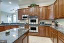 Gourmet Kitchen with Double Oven and SS Appliances - 42966 CORALBELLS PL, LEESBURG