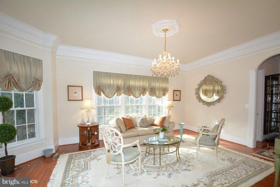 Formal Living Room with custom window treatments - 4200 PINERIDGE DR, ANNANDALE