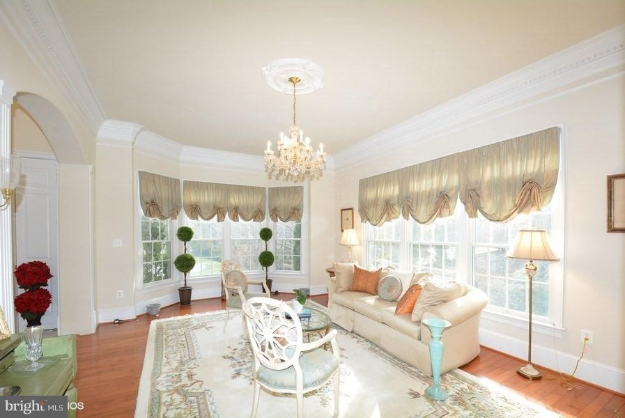 Living Rm w/hrdwd & crystal chandelier - 4200 PINERIDGE DR, ANNANDALE