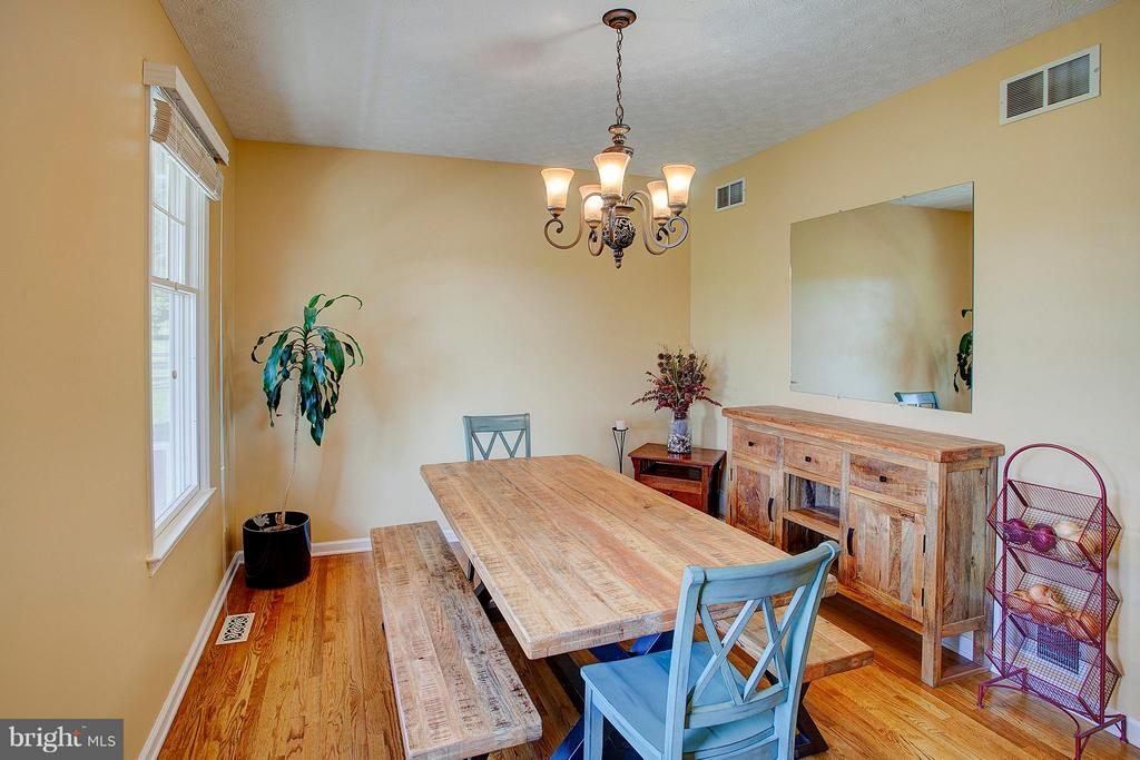 Great natural light in the dining room. - 35086 HARRY BYRD HWY, ROUND HILL