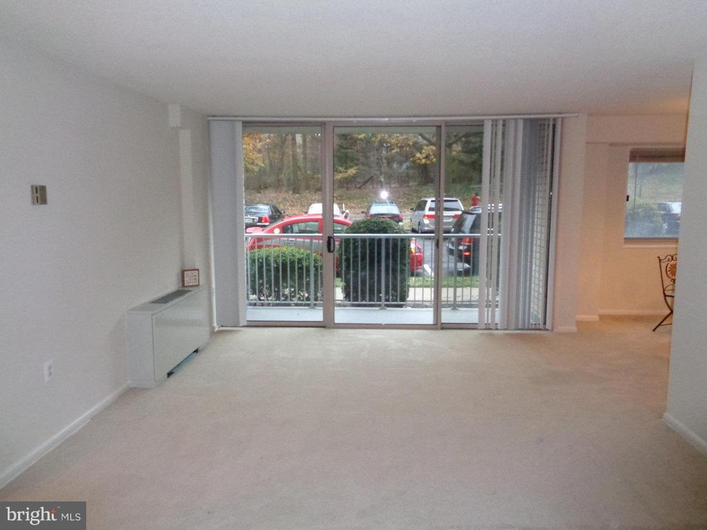 Balcony is right off living room space--faces park - 2500 VAN DORN ST N #124, ALEXANDRIA