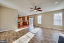 Luxury vinyl plank floors highlight family room - 81 FOUNTAIN DR, STAFFORD