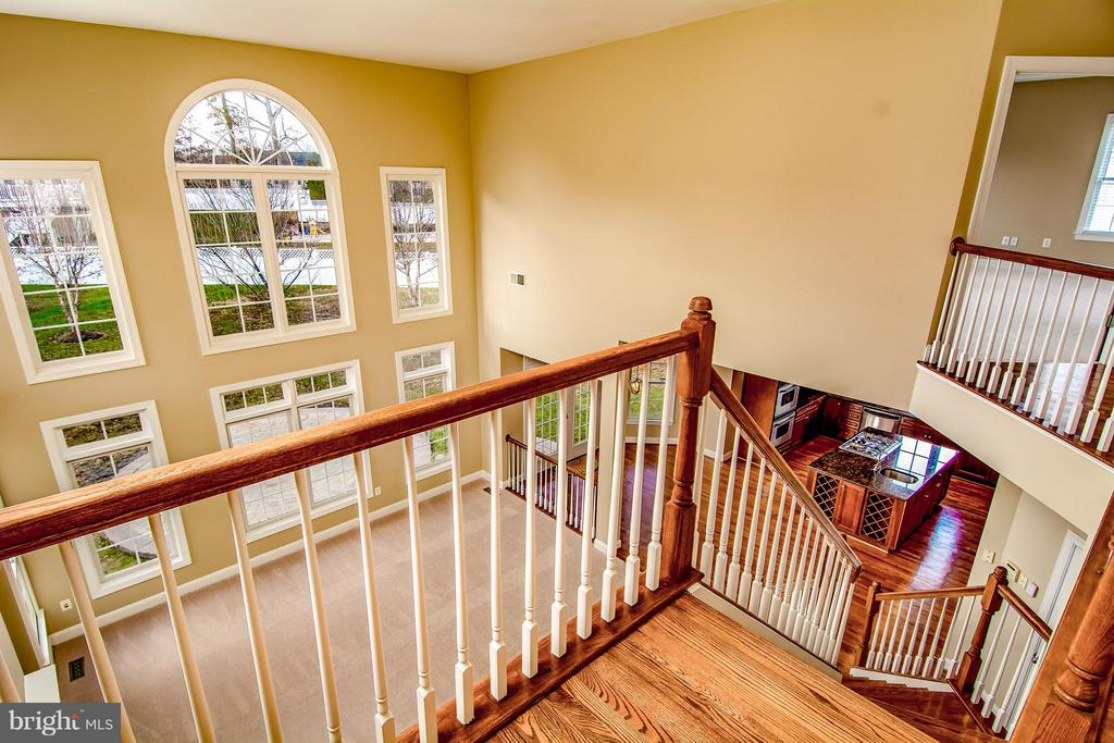 VIEW OF FAMILY ROOM FROM UPPER LEVEL FOYER - 12282 TIDESWELL MILL CT, WOODBRIDGE