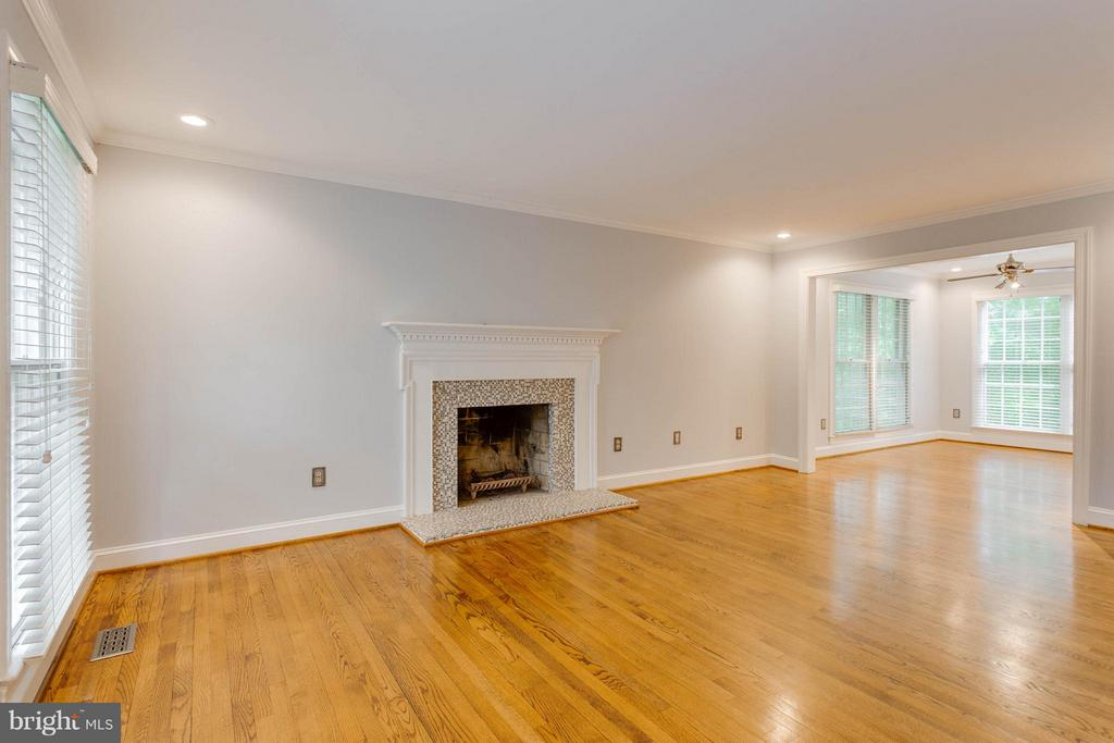 Living Room with Wood Burning  Fireplace - 10637 AVONDALE DR, MANASSAS