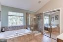 Updated bath with oversize tub, one of 2 WIC - 6412 TINKLING SPRINGS CT, MANASSAS