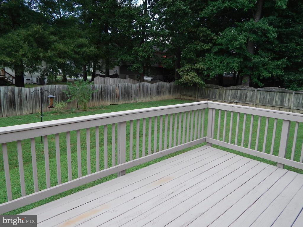 Rear deck with view of fence and back yard trees - 10123 SOUTH FULTON DR, FREDERICKSBURG