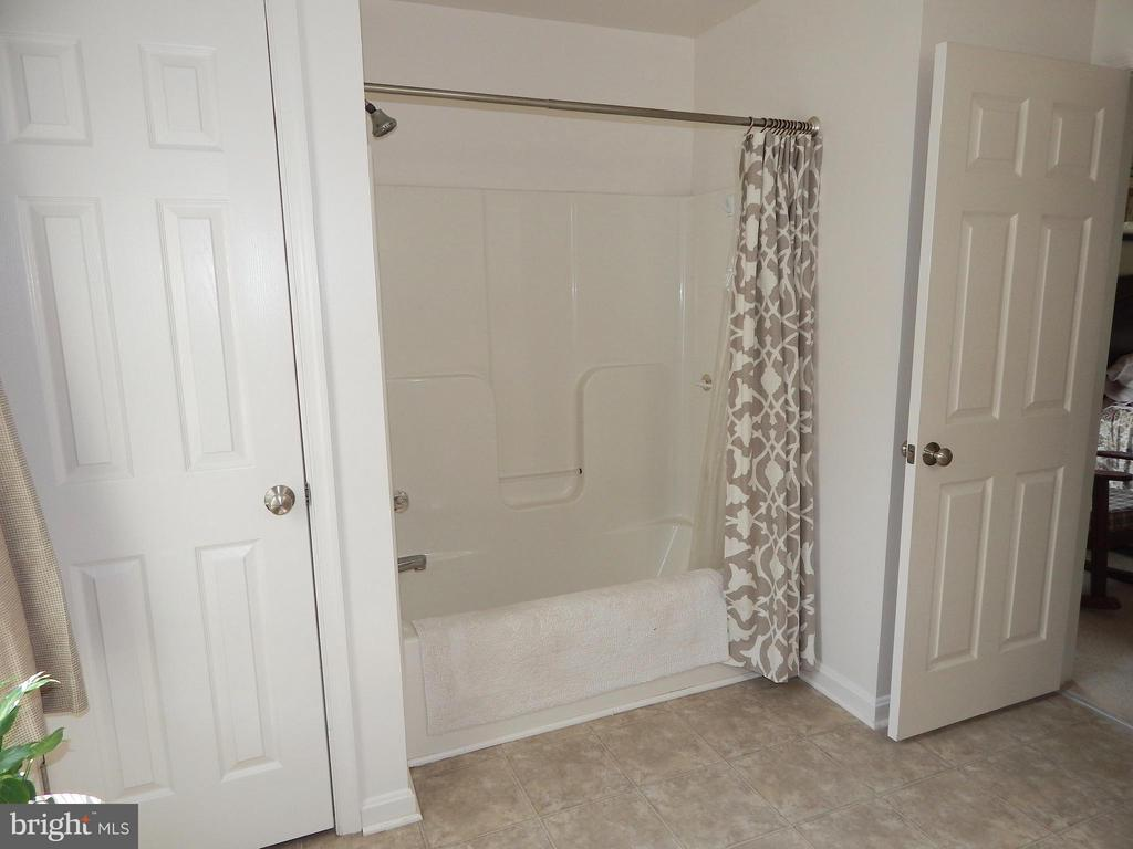 Master bath view 2 of tub and linen/storage closet - 10123 SOUTH FULTON DR, FREDERICKSBURG