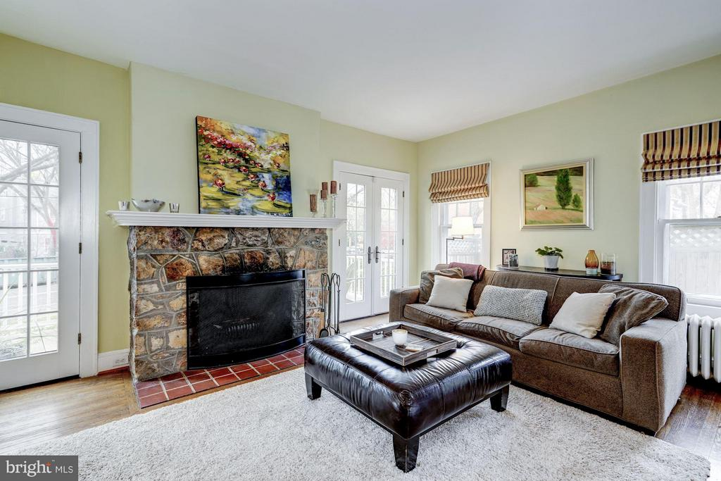 Large light-filled living room with fireplace - 5709 NEVADA AVE NW, WASHINGTON
