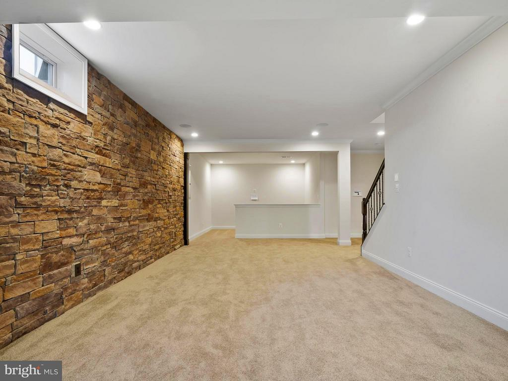 FINISHED Basement with stone Accent Wall - 41433 AUTUMN SUN DR, ALDIE