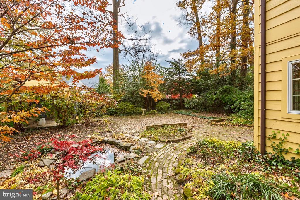 Koi pond and leafy trees adorn the backyard - 6613 32ND ST NW, WASHINGTON