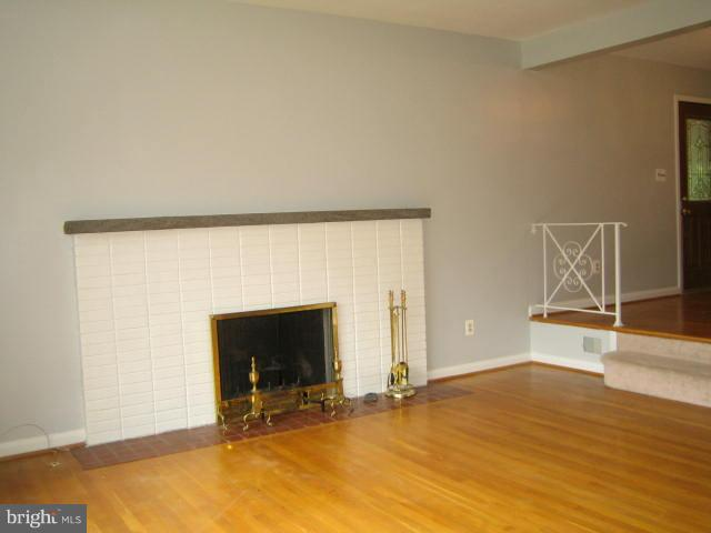 Living room with gas fireplace to dining room - 6131 BEACHWAY, FALLS CHURCH