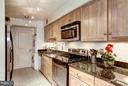 Renovated Chef's Kitchen w/New Cabinetry - 4200 MASSACHUSETTS AVE NW #120, WASHINGTON