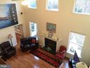 TWO-STORY wall of windows & Rosewood floors.. - 6142 WALKERS HOLLOW WAY, LOCUST GROVE