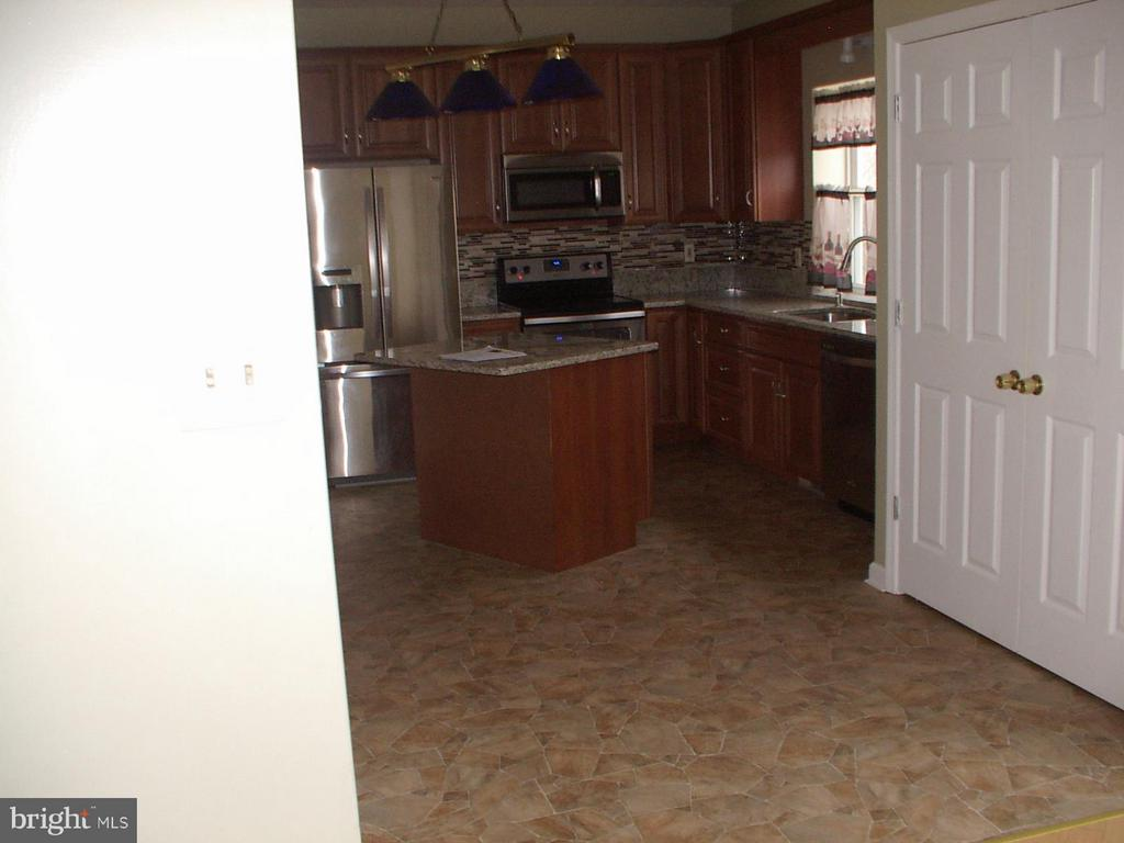 Kitchen with washer/dryer room - 1919 WITHERS LARUE RD., BERRYVILLE