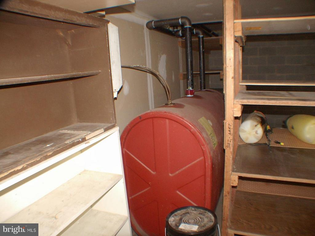 Oil tank at rear of garage, Also has heat pump - 1919 WITHERS LARUE RD., BERRYVILLE